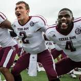 Texas A&M wide receiver Nate Askew (9), quarterback Johnny Manziel (2) and defensive back Toney Hurd Jr., (4) sing the Aggie War Hymn following the Aggies  48-3 victory over Southern Methodist in an NCAA football game at Ford Stadium, Saturday, Sept. 15, 2012, in Dallas. ( Smiley N. Pool / Houston Chronicle ) (Houston Chronicle)