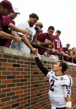 Texas A&M quarterback Johnny Manziel (2) celebrates with fans following the Aggies  48-3 victory over Southern Methodist in an NCAA football game at Ford Stadium, Saturday, Sept. 15, 2012, in Dallas. ( Smiley N. Pool / Houston Chronicle ) (Houston Chronicle)