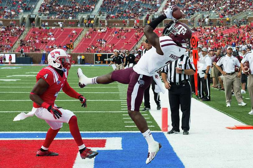 Texas A&M wide receiver Uzoma Nwachukwu (7) hauls in a touchdown as Southern Methodist defensive bac