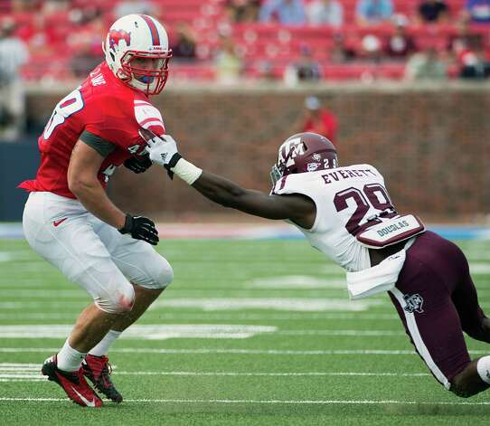 Southern Methodist running back Zach Line (48) is tackled by Texas A&M defensive back Deshazor Everett (29) during the second half of an NCAA football game at Ford Stadium, Saturday, Sept. 15, 2012, in Dallas. Texas A&M won the game 48-3. Photo: Smiley N. Pool, Houston Chronicle / © 2012  Houston Chronicle