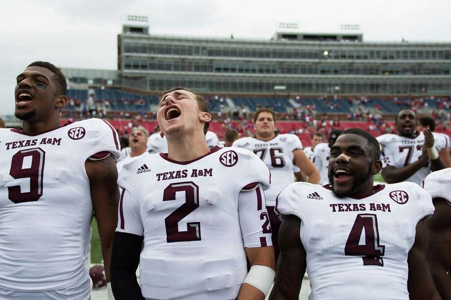 Texas A&M wide receiver Nate Askew (9), quarterback Johnny Manziel (2) and defensive back Toney Hurd Jr., (4) sing the Aggie War Hymn following the Aggies  48-3 victory over Southern Methodist in an NCAA football game at Ford Stadium, Saturday, Sept. 15, 2012, in Dallas. Photo: Smiley N. Pool, Houston Chronicle / © 2012  Houston Chronicle