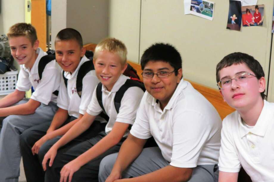 Seventh- and eighth-grade boys at All Saints Catholic Academy in Albany are lined up waiting to go to their homerooms as the new school year begins at the school. They are from left, seventh-graders Zachary, Christian and Adam, eighth-grader Shahzail and seventh-grader Audie. (Last names not provided).