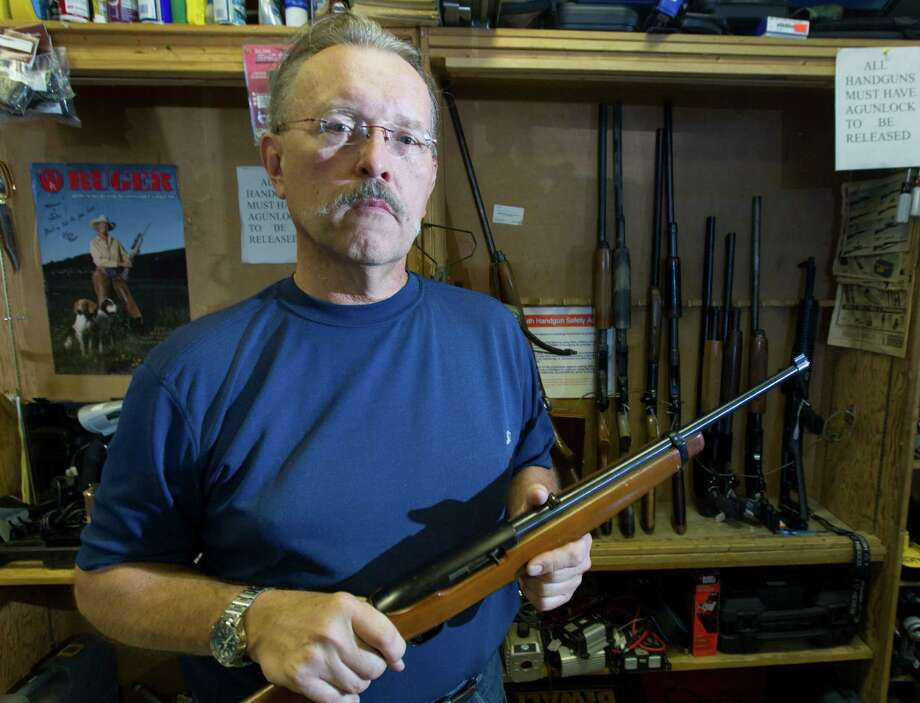 Pawnshop manager John Bialkoski's store was struck by serial burglars who entered through the roof and took 10 rifles. Photo: Cody Duty / © 2011 Houston Chronicle