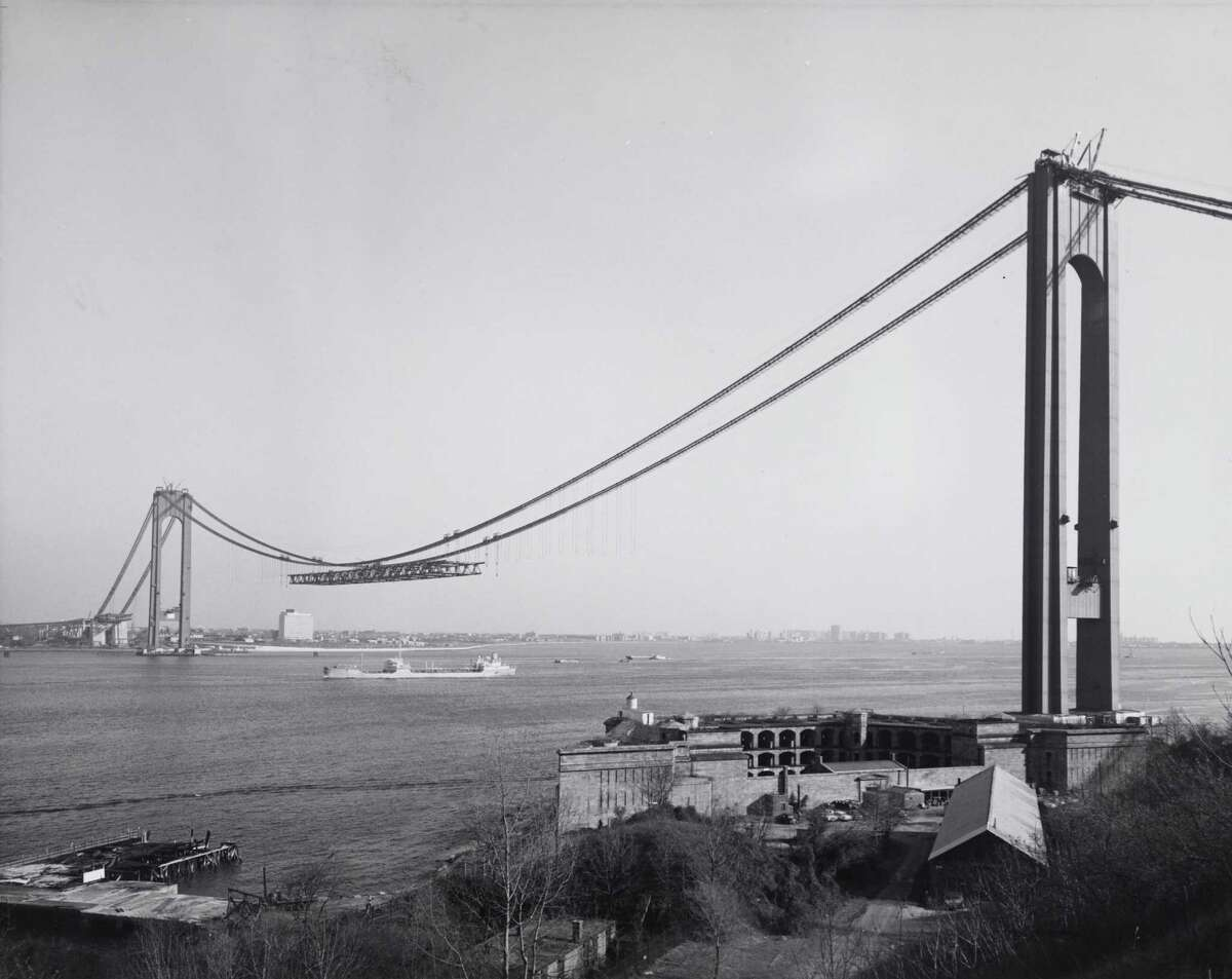 This Dec. 4, 1963 photo provided by the Museum of the City of New York shows New York's Verrazano-Narrows Bridge, linking Brooklyn to Staten Island, under construction. Beyond the ferry, the Verrazano-Narrows Bridge and maybe the Fresh Kills landfill, few people outside Staten Island know of its rich history as a strategic site in New York Harbor, a farming center, a recreational haven and a suburban retreat. A new exhibition aims to rectify that. ?