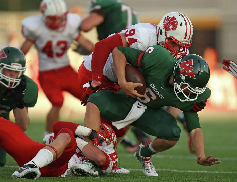 Katy 63, The Woodlands 10The Woodlands' quarterback Blaine Gillespie (6) is sacked by Katy's Colton Asheim (22) during the first half of a high school football game, Saturday, September 15, 2012 at Woodforest Bank Stadium in Shenandoah, TX. Photo: Eric Christian Smith, For The Chronicle