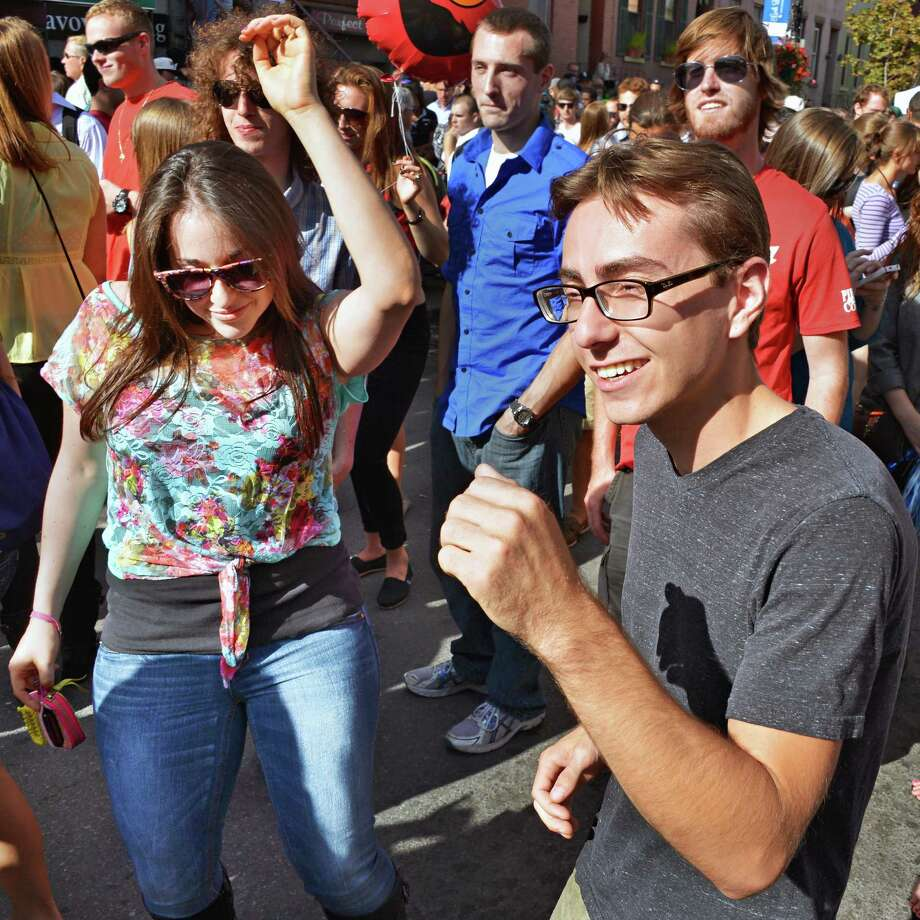 Lara Schechtman and Sam Piazza, both of latham, dance to the bands at LarkFEST 2012, New York's largest one-day street festival celebrating the Heart of Albany, Saturday Sept. 15, 2012.  (John Carl D'Annibale / Times Union) Photo: John Carl D'Annibale / 00019222A