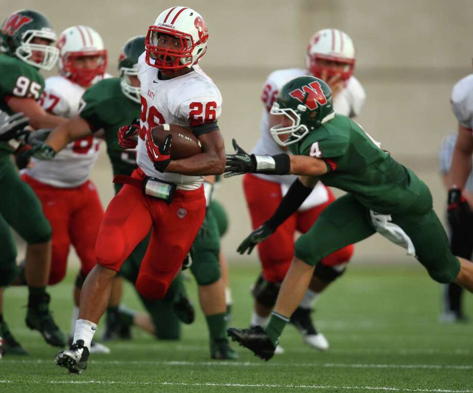 Katy's Rodney Anderson (26) escapes the grasp of The Woodlands' Tyler Patrick during the first half of a high school football game, Saturday, September 15, 2012 at Woodforest Bank Stadium in Shenandoah, TX. Photo: Eric Christian Smith, For The Chronicle