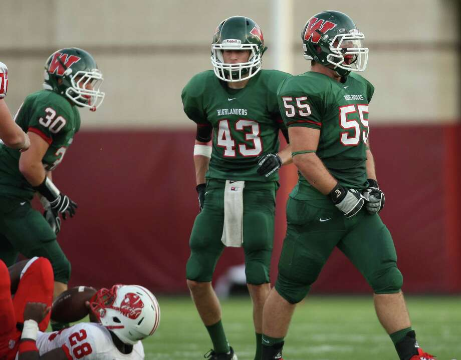 The Woodlands' Clayton Lowell (55) yells after tackling Katy's Adam Taylor (28) for a loss during the first half of a high school football game, Saturday, September 15, 2012 at Woodforest Bank Stadium in Shenandoah, TX. Photo: Eric Christian Smith, For The Chronicle