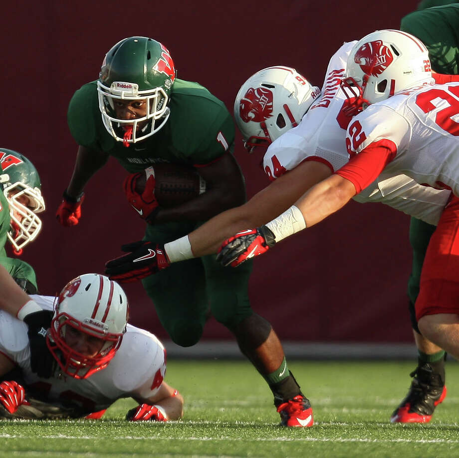 The Woodlands' running back Patrick Carr (1) look for running room against Katy during the first half of a high school football game, Saturday, September 15, 2012 at Woodforest Bank Stadium in Shenandoah, TX. Photo: Eric Christian Smith, For The Chronicle