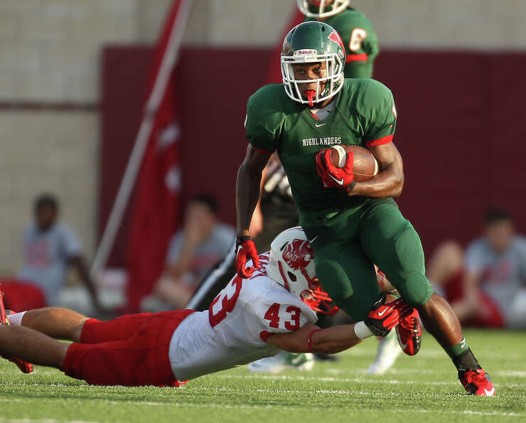 The Woodlands' Patrick Carr (1) scampers past Katy's Cole Barry during the first half of a high scho
