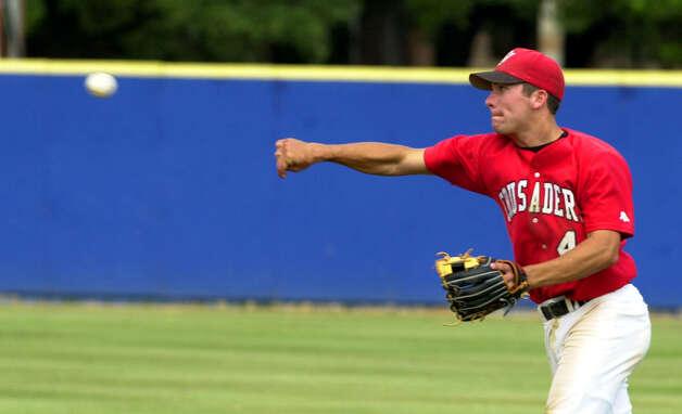 Incarnate Word's Jerod Fikac (4) throws to first to get St. Edwards' Ryan Wilkins (2) out during the 5th inning Friday May 10, 2002 at V J Keefe Field.  EDWARD A. ORNELAS/STAFF Photo: EDWARD A. ORNELAS, Express-News / SAN ANTONIO EXPRESS-NEWS