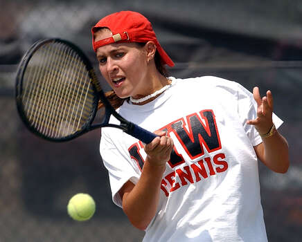 Angel Batkins of the IWU Tennis team practices Tuesday April 30, 2002.The IWU team will compete for the second year in a row in the NCAA Division II national Tournament. Photo: KEVIN GEIL, Express-News / SAN ANTONIO EXPRESS-NEWS