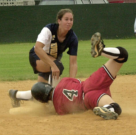 Incarnate Word base runner Tracie Tirres gets taged out by St Edwards Gennifer Eskew on a steal to second Thursday afternoon at IWU.(EXPRESS NEWS/STAFF PHOTO BY DELCIA LOPEZ Photo: DELCIA LOPEZ, Express-News / en