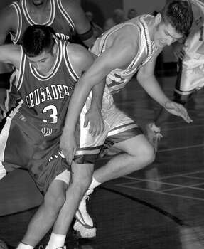 IWC's Chris Olivares (3) fights for a loose ball against Jeff Padalecki (32) of St. Mary's during first half action Wed. Jan. 26, 2000 at St. Mary's University. Incarnate Word's men's basketball team rose to prominence in the 1990s and was nationally ranked for the first time in January 1993 in the NAIA. Photo: KEVIN GEIL, Express-News / SAN ANTONIO EXPRESS-NEWS