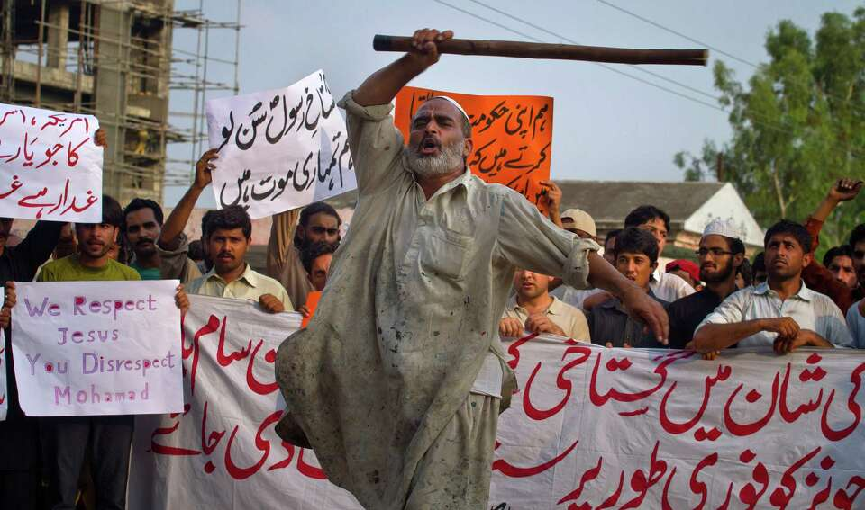 A Pakistani worker shouts anti U.S. slogans during a rally in Islamabad, Pakistan on Saturday, Sept.