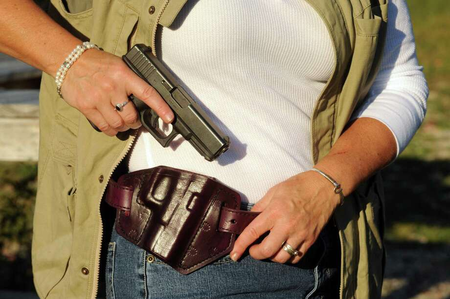 Trish Cutler wears her purple leather Glock holster and matching belt by Jesse Leather during a target practice session at the Hudson Fish and Game Club in Hudson, N.Y., Thursday Sept. 13, 2012. (Michael P. Farrell/Times Union) Photo: Michael P. Farrell