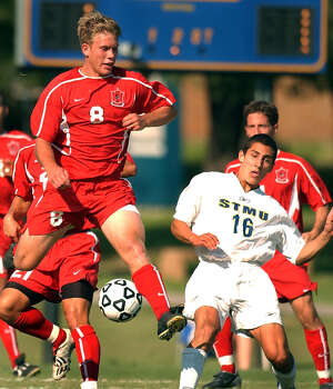 SPORTS - Incarnate Word's Nicholas Pertuit (8) battles St. Mary's John Gray for the ball during first-half action at St. Mary's University on Tuesday, Sept. 30, 2003. BILLY CALZADA / STAFF Photo: BILLY CALZADA, Express-News / SAN ANTONIO EXPRESS-NEWS