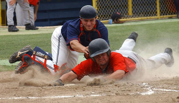 UIW's John Elia slides across home plate Saturday May 10, 2003, at St. Mary's University as Dallas Baptist's John Schindler goes for the tag during the Heartland Conference championships. (WILLIAM LUTHER/STAFF) Photo: WILLIAM LUTHER, Express-News / SAN ANTONIO EXPRESS-NEWS