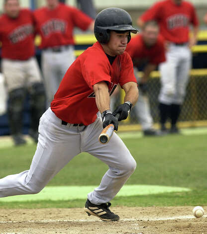 SPORTS --- University of the Incarnate Word's Jerod Fikac bunts Saturday May 10, 2003, at St. Mary's University during the Crusaders' game against the Dallas Baptist Patriots during the Heartland Conference championships. (WILLIAM LUTHER/STAFF) Photo: WILLIAM LUTHER, Express-News / SAN ANTONIO EXPRESS-NEWS