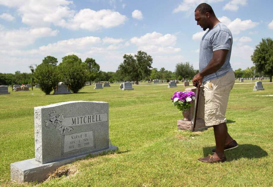 Houston Texans defensive lineman Earl Mitchell visits the grave of his grandmother, Narnie Mitchell, on Tuesday, Sept. 11, 2012, in Houston.   Mitchell spent much of his childhood with his grandmother, who died in 2001. Photo: Brett Coomer, Houston Chronicle / © 2012 Houston Chronicle