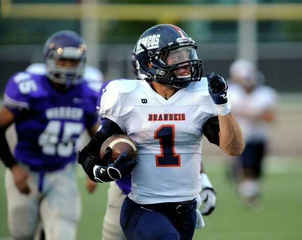 Brandeis running back Trinton Ynclan (1) scores on the first play from scrimmage against Warren during high-school football action at Gustafson Stadium on Saturday, Sept. 15, 2012. Photo: Billy Calzada, San Antonio Express-News / © San Antonio Express-News