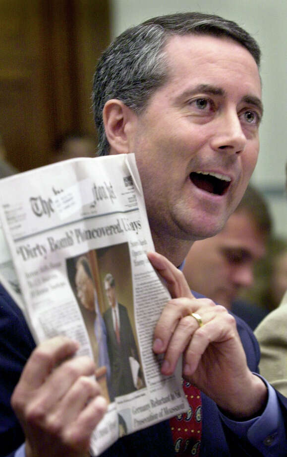 """Rep. William """"Mac"""" Thornberry, R-Texas, holds up a newspaper headline about uncovering a plot to explode a 'dirty bomb,' during Thornberry's testimony before the House Government Reform subcommittee on national security at a Capitol Hill hearing on federal reorganization to combat terrorism, Tuesday, June 11, 2002, in Washington. He was one of six lawmakers who have been pushing creation of a Homeland Security Department for months and praised the thrust of President Bush's new proposal at the hearing.(AP Photo/Kenneth Lambert) Photo: KENNETH LAMBERT / AP"""