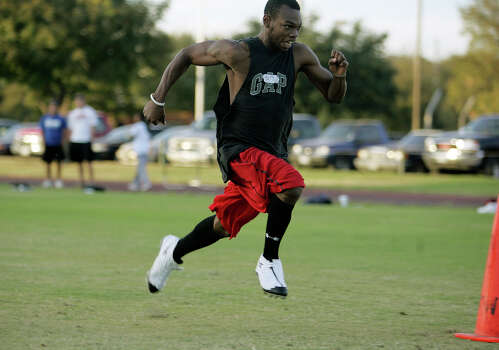 Former high school football standout Jerrell Wilkerson runs the 40 yard dash for time during UIW football tryouts Tuesday, November 27. BAHRAM MARK SOBHANI/STAFF Photo: BAHRAM MARK SOBHANI, Express-News / SAN ANTONIO EXPRESS NEWS