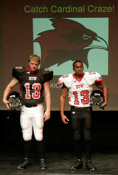 Dan Manz, in dark uniform, and Everett Rusher, in white uniform, pose Saturday afternoon Nov. 17, 2007 in the University of the Incarnate Word's newly unveiled football uniforms with UIW president Dr. Louis Agnese Jr. Photo: WILLIAM LUTHER, Express-News / SAN ANTONIO EXPRESS-NEWS
