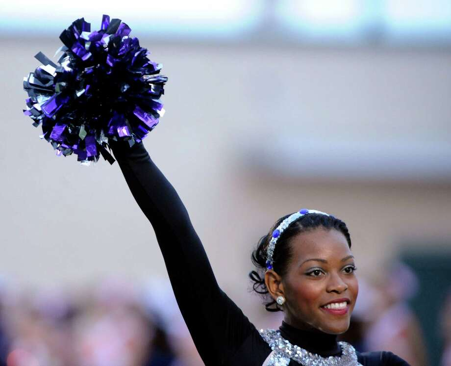 A Warren dance team member cheers during high-school football action at Gustafson Stadium on Saturday, Sept. 15, 2012. Photo: Billy Calzada, San Antonio Express-News / © San Antonio Express-News