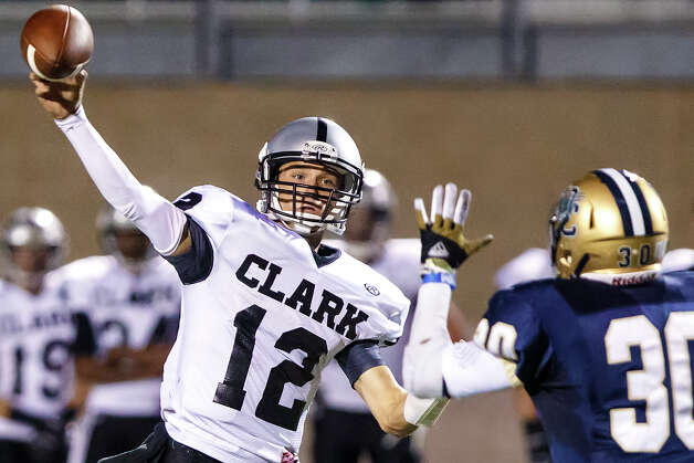 Clark quarterback Chase Jones gets a pass off as O'Connor's Marces Garza Dishman applies pressure during their game at Farris Stadium on Sept. 14, 2012.  MARVIN PFEIFFER/ mpfeiffer@express-news.net Photo: MARVIN PFEIFFER, Express-News / Express-News 2012