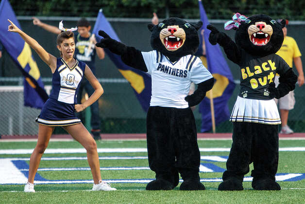 The O'Connor mascots sing the school song with the cheerleaders prior to their game with Clark at Farris Stadium on Sept. 14, 2012.  MARVIN PFEIFFER/ mpfeiffer@express-news.net Photo: MARVIN PFEIFFER, Express-News / Express-News 2012