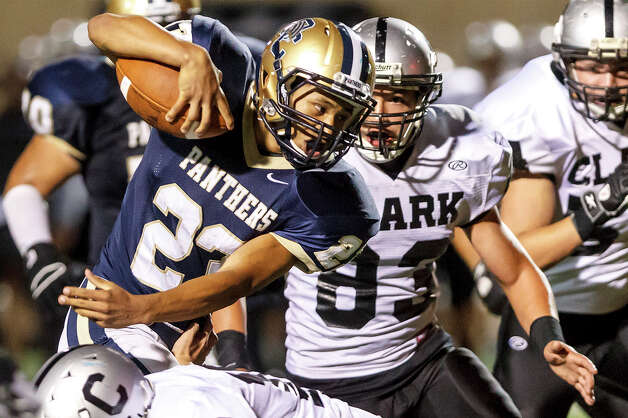 O'Connor running back Xavier Guilen (left) fights for yardage as Clark's Timothy Rodriguez closes in during the fourth quarter of their game at Farris Stadium on Sept. 14, 2012. O'Connor won the game 52-19.  MARVIN PFEIFFER/ mpfeiffer@express-news.net Photo: MARVIN PFEIFFER, Express-News / Express-News 2012
