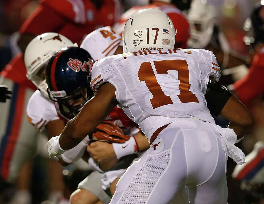 OXFORD, MS - SEPTEMBER 15:  Bo Wallace #14 of the Ole Miss Rebels is sacked by Jackson Jeffcoat #44 and Adrian Phillips #17 of the Texas Longhorns at Vaught-Hemingway Stadium on September 15, 2012 in Oxford, Mississippi. Photo: Scott Halleran, Getty Images / 2012 Getty Images