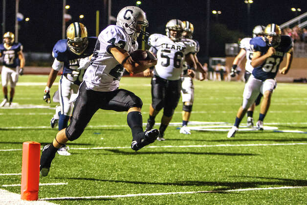 Clark's Brandon Valle crosses the goal line on an 18-yard touchdown run during the second quarter of their game with O'Connor at Farris Stadium on Sept. 14, 2012.  MARVIN PFEIFFER/ mpfeiffer@express-news.net Photo: MARVIN PFEIFFER, Express-News / Express-News 2012
