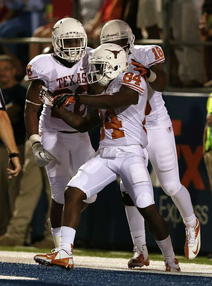 OXFORD, MS - SEPTEMBER 15:  Marquise Goodwin #84 of the Texas Longhorns celebrates with his teammates after a 69-yard touchdown against the Ole Miss Rebels at Vaught-Hemingway Stadium on September 15, 2012 in Oxford, Mississippi. Photo: Scott Halleran, Getty Images / 2012 Getty Images