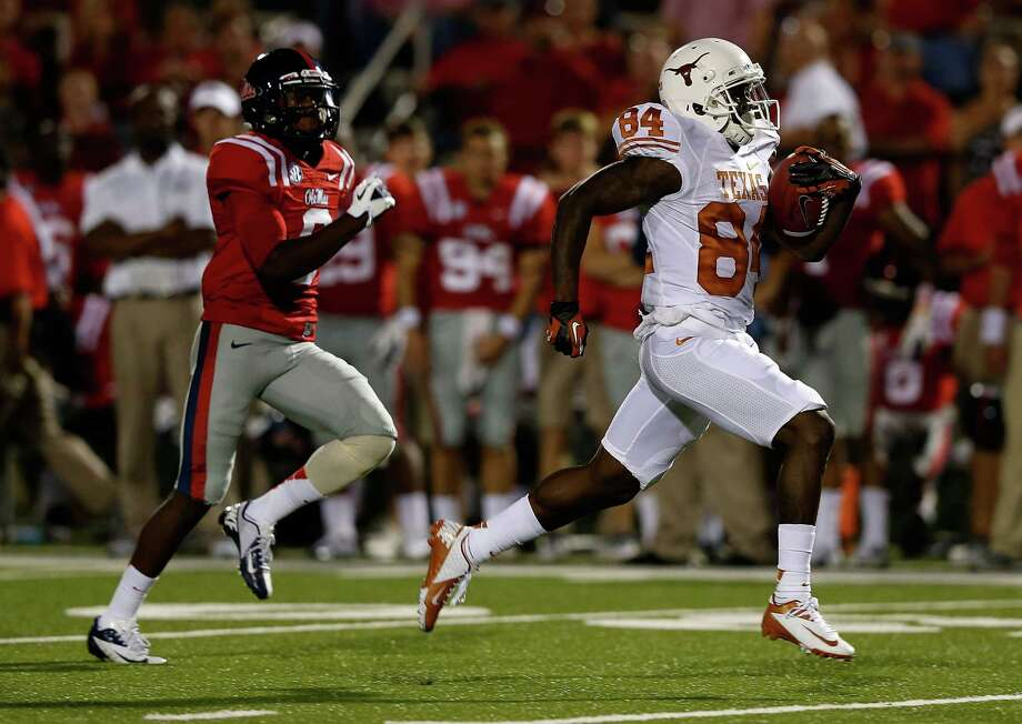 OXFORD, MS - SEPTEMBER 15:  Marquise Goodwin #84 of the Texas Longhorns runs past Wesley Pendleton #6 of the Ole Miss Rebels for a 69-yard touchdown at Vaught-Hemingway Stadium on September 15, 2012 in Oxford, Mississippi. Photo: Scott Halleran, Getty Images / 2012 Getty Images