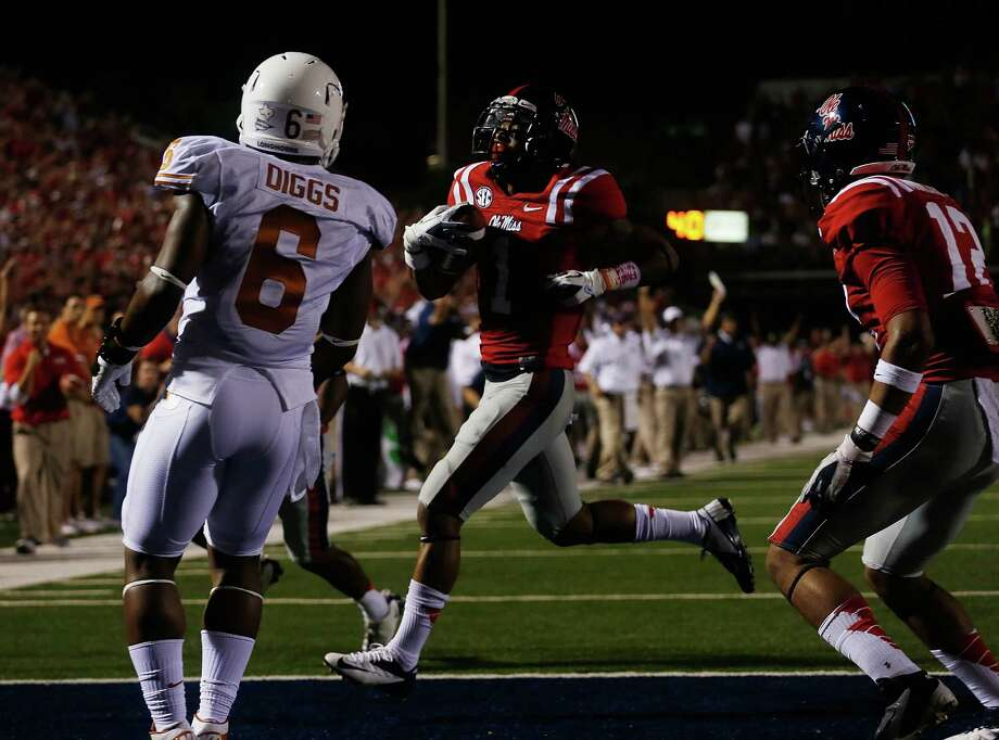 OXFORD, MS - SEPTEMBER 15:  Randall Mackey  #1 of the Ole Miss Rebels runs for a touchdown against the Texas Longhorns at Vaught-Hemingway Stadium on September 15, 2012 in Oxford, Mississippi. Photo: Scott Halleran, Getty Images / 2012 Getty Images