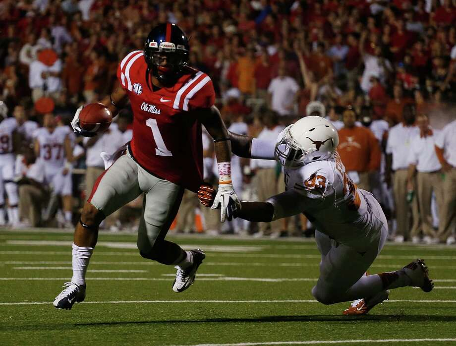 OXFORD, MS - SEPTEMBER 15:  Randall Mackey  #1 of the Ole Miss Rebels runs for a touchdown against the reach of Steve Edmond #33 the Texas Longhorns at Vaught-Hemingway Stadium on September 15, 2012 in Oxford, Mississippi. Photo: Scott Halleran, Getty Images / 2012 Getty Images