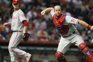 Phillies catcher Erik Kratz (31) makes the ground out throw to first base on Jose Altuve (27) during the fifth inning.  ( Karen Warren / Houston Chronicle ) (Karen Warren / Houston Chronicle)