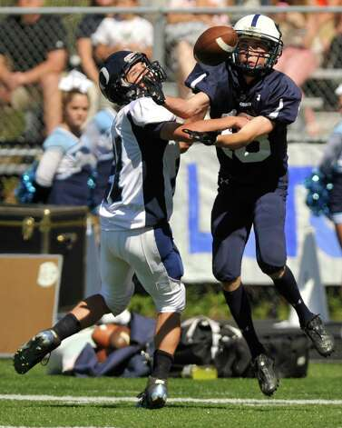 Oxford's Steve Persson and Immaculate's Shane Murphy compete for the reception intended for Murphy during their game at Immaculate High School in Danbury on Saturday, Sept. 15, 2012. Oxford won, 35-0. Photo: Jason Rearick / The News-Times
