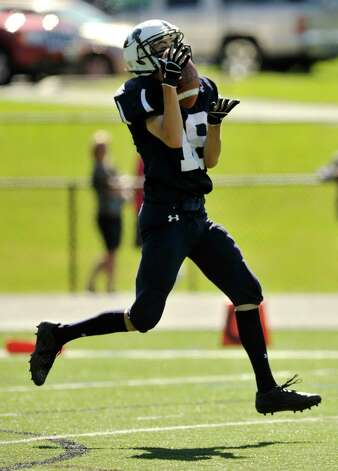 Immaculate's Shane Murphy catches the ball during a kickoff return during their game against Oxford at Immaculate High School in Danbury on Saturday, Sept. 15, 2012. Oxford won, 35-0. Photo: Jason Rearick / The News-Times