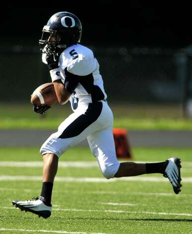 Oxford's Owen Diaz runs the ball during their game against Immaculate at Immaculate High School in Danbury on Saturday, Sept. 15, 2012. Oxford won, 35-0. Photo: Jason Rearick / The News-Times
