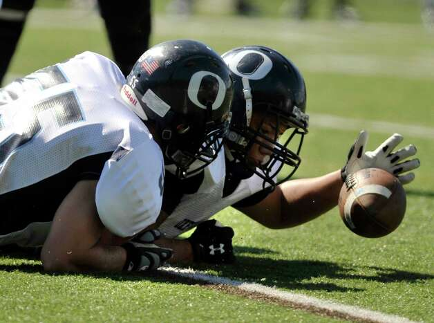Oxford's Noah Lisewski, left, and Dion Major scramble to come up with a fumble during their game against Immaculate at Immaculate High School in Danbury on Saturday, Sept. 15, 2012. Oxford won, 35-0. Photo: Jason Rearick / The News-Times