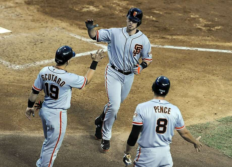 PHOENIX, AZ - SEPTEMBER 15:  Buster Posey #28 of the San Francisco Giants celebrates a home run with teammates Marco Scutaro #19 and Hunter Pence #8 against the Arizona Diamondbacks at Chase Field on September 15, 2012 in Phoenix, Arizona.  (Photo by Norm Hall/Getty Images) Photo: Norm Hall, Getty Images