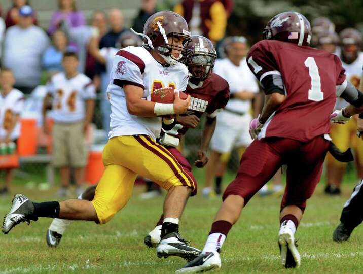 Fonda's Pat Hart (22), center, runs through Watervliet's defense to score a touchdown on Saturday, S