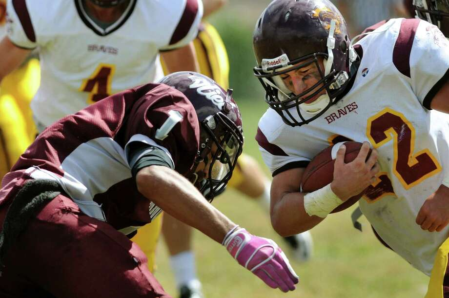 Fonda's Pat Hart (22), right, goes head-to-head with Watervliet's Tyler Bennett (1) during their football game on Saturday, Sept. 15, 2012, at Watervliet High in Watervliet, N.Y. (Cindy Schultz / Times Union) Photo: Cindy Schultz / 00019194A