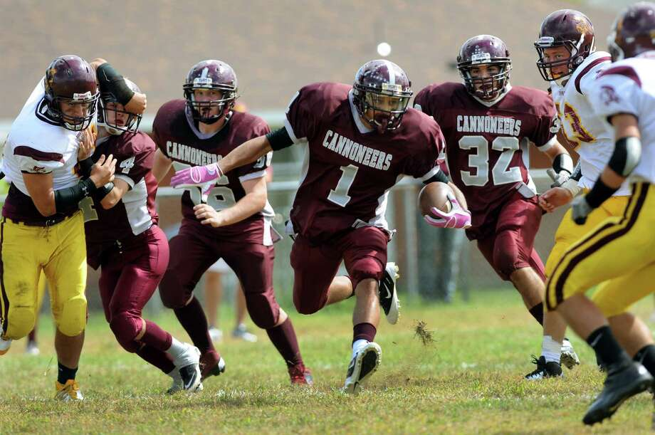 Watervliet's Tyler Bennett (1), center, runs the ball during their football game on Saturday, Sept. 15, 2012, at Watervliet High in Watervliet, N.Y. (Cindy Schultz / Times Union) Photo: Cindy Schultz / 00019194A
