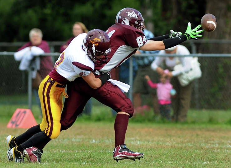 Watervliet's Charles Labelle (84), right, can't reach a pass as Fonda's Jake Sammons (17) defends du
