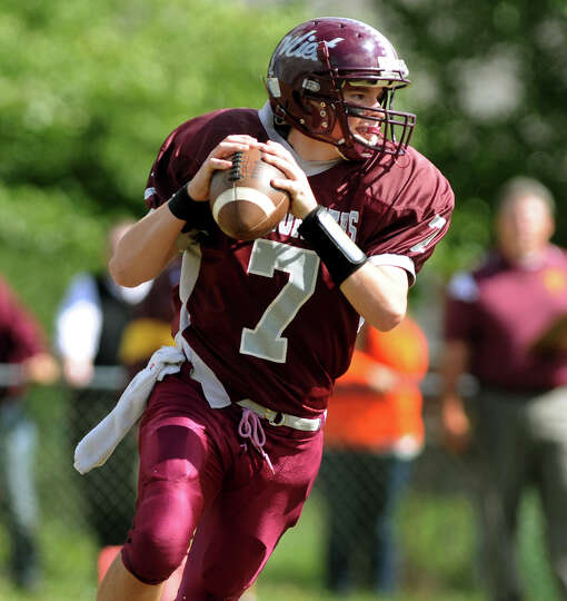 Watervliet's quarterback Anthony Halpin (7) looks to pass during their football game against Fonda o