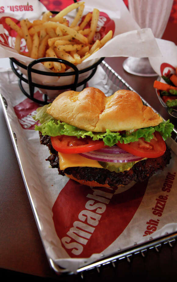 Smashburger Classic Regular Smashburger, 720 calories. (A Big is 840 and a Small is 600.) Smashfries, 470 calories. Photo: San Antonio Express-News File Photo / nfruge@express-news.net
